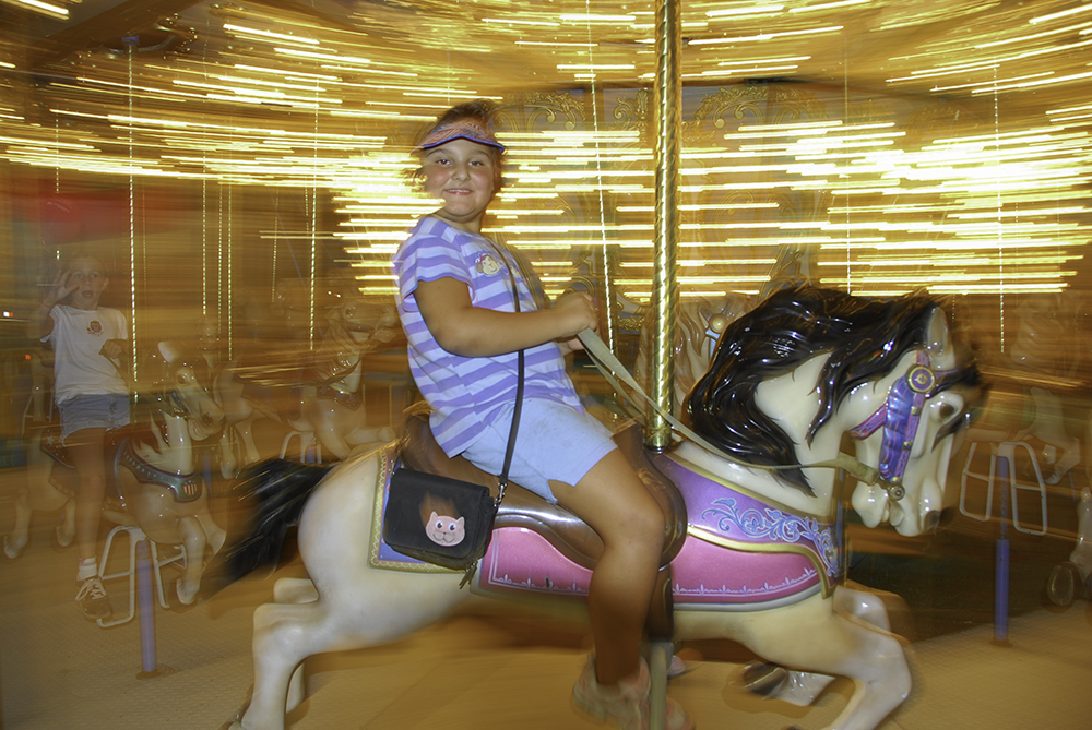 Seven year old girl on a Merry-go-Round, Stanly County Fair, North Carolina. (MR)