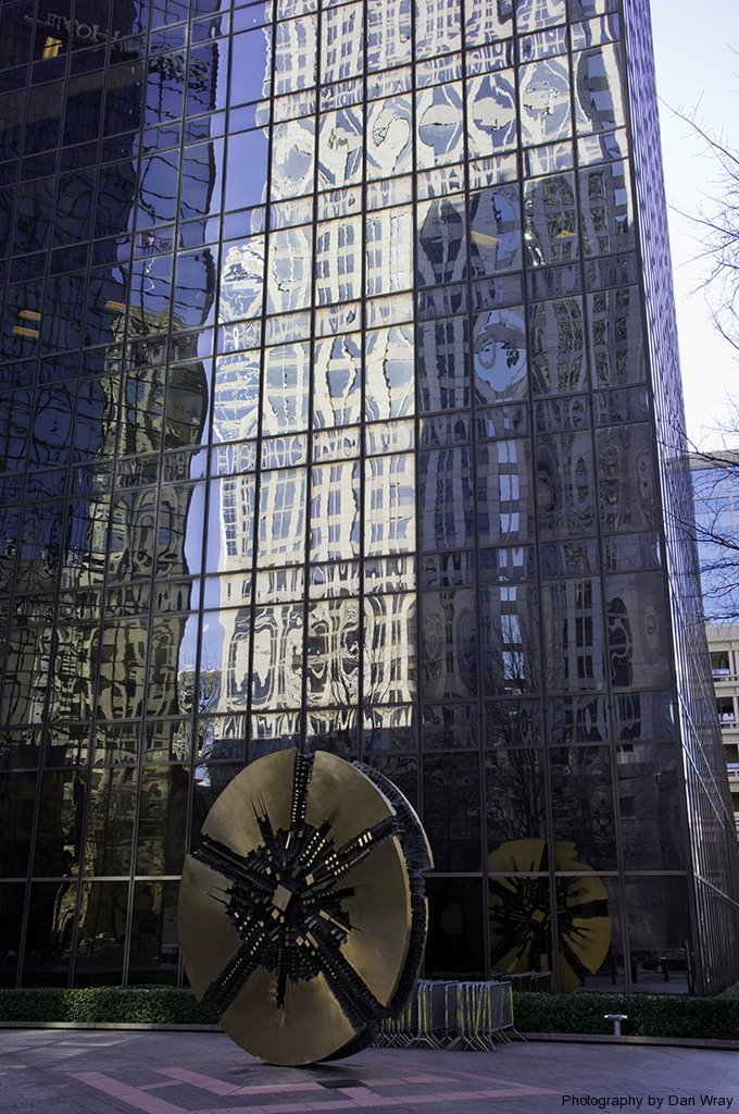 Three dimentional art and building reflections, Trade and Tryon streets, uptown Charlotte, North Carolina.
