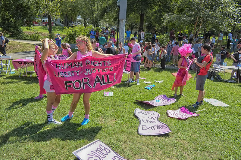 "The gathering of protestors in Frazier Park, Charlotte, North Carolina prior to the Democratic National Convention, 2012.  This demonstration was sponsored by the Coalition to March on Wall Street South with over 80 groups with separate issues involved. Here the ""Code Pink"" group prepares to march."