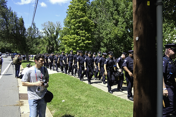 The gathering of protestors in Frazier Park, Charlotte, North Carolina prior to the Democratic National Convention, 2012, is characterized by a heavy police presence. This demonstration was sponsored by the Coalition to March on Wall Street South with over 80 groups with separate issues involved.