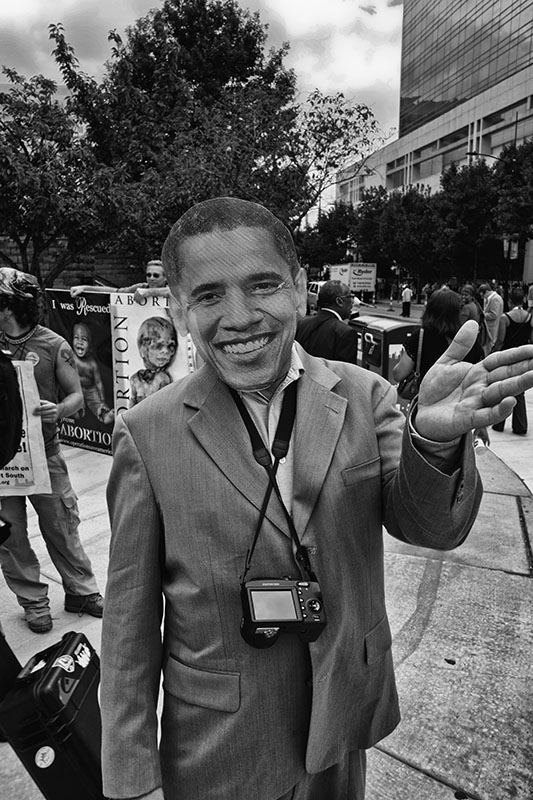 A man wearing an Obama mask during the Democratic National Convention,2012, in front of the Charlotte, North Carolina Convention Center.
