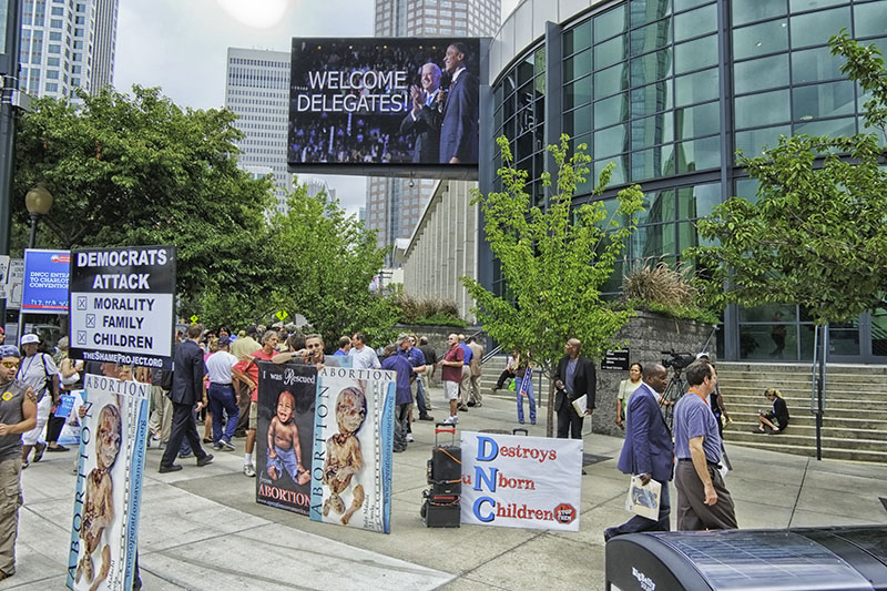 Two street preachers set up in front of the Charlotte, North Carolina Convention Center decrying some of the positions of the Democratic Platform during the Democratic National Convention, 2012.