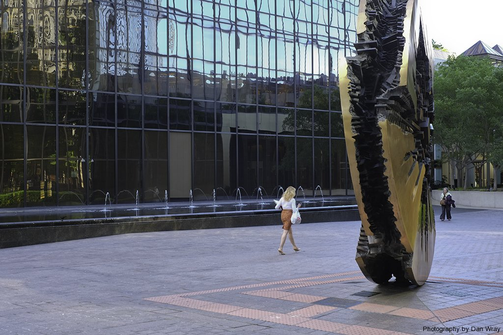 Grande Disco sculpture in center of Charlotte, North Carolina at Trde and Tryon streets. The art is by Arnaldo Pomodoro. The plaque is dated Octobeer 2, 1974.