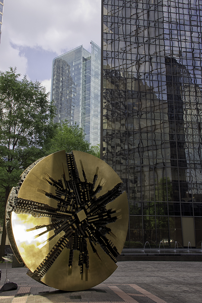 Grande Disco sculpture in center of Charlotte, North Carolina at Trade and Tryon streets. The art is by Arnaldo Pomodoro. The plaque is dated Octobeer 2, 1974.