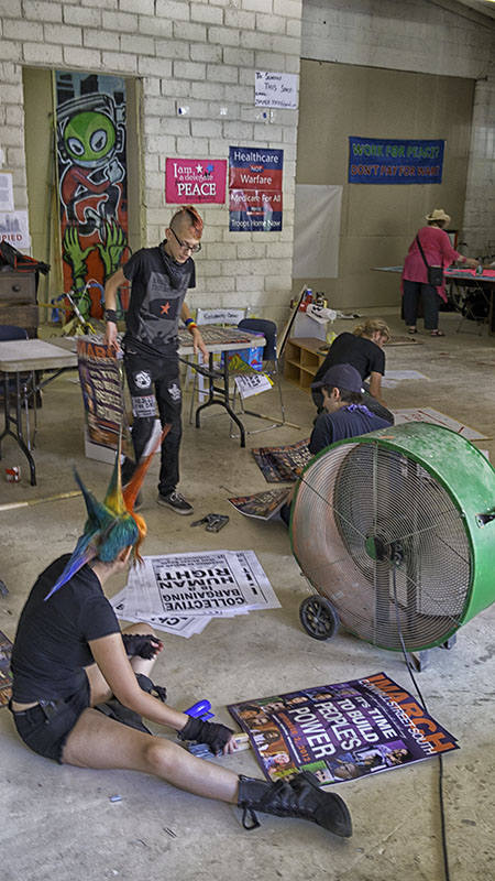 Volunteers for the Coalition to March on Wall St. South assembling posters at the Liberation Fest (Festivaliberacion) in Area 15, Charlotte, North Carolina.
