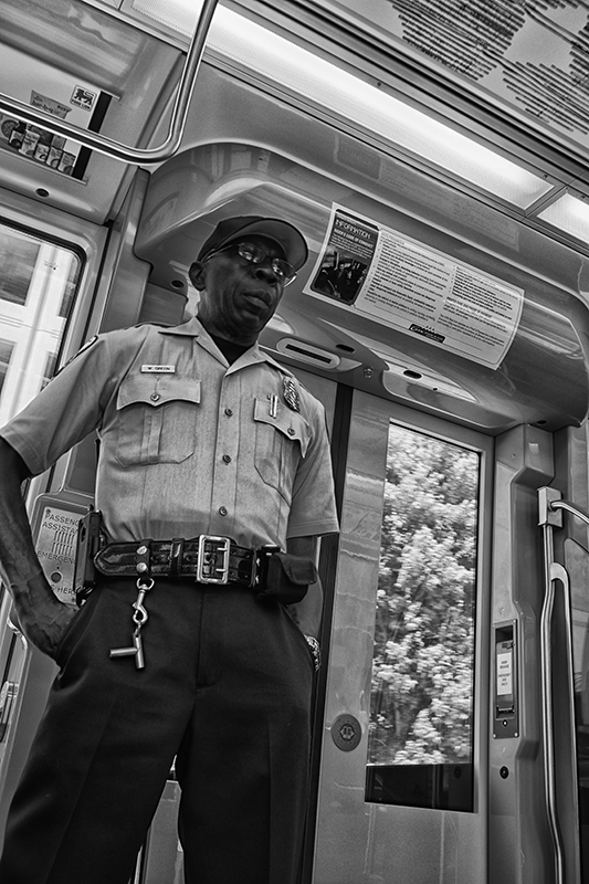 Security officer on Blue Line commuter train, Charlotte, North Carolina.