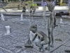 Sculptures of children playing at a fountain in uptown Charlotte, North Carolina.