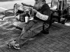 Grey bearded man on bench, uptown Charlotte, North Carolina.