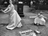 Two young women in wedding dresses doing street performance dance in uptown Charlotte, North Carolina, advocating for votes against Amendment One defining marriage as between a man and a woman, scheduled for vote May 8, 2012.