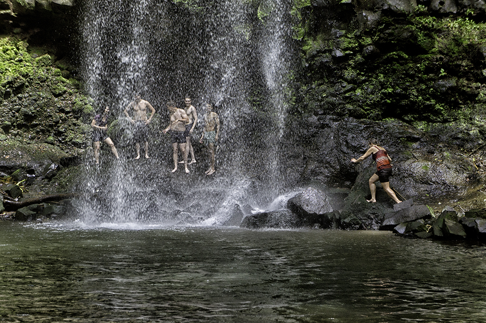 People swimming below the Waterfall of Los Angeles in Atenas, Costa Rica. Note the volcanic columnar rock formation.