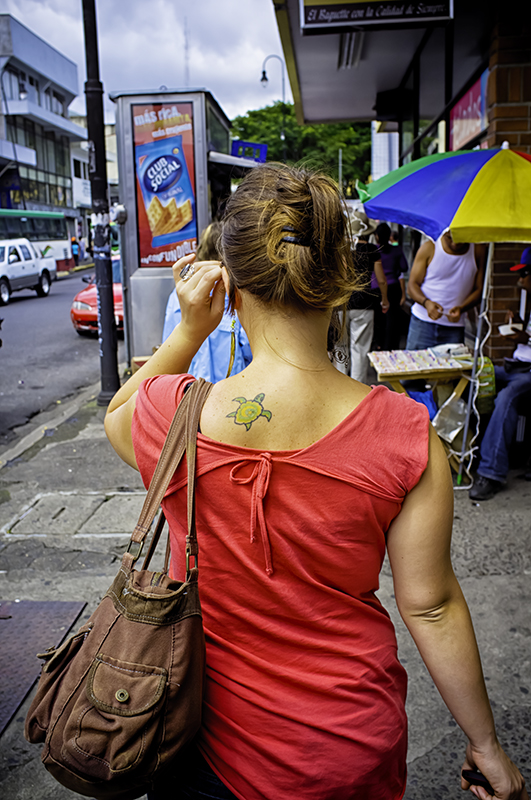 On the street in San Jose, Costa Rica. Turtle tatoo.