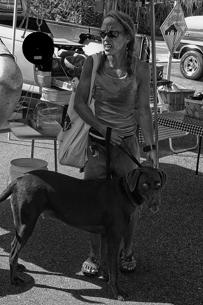 Woman and her dog at the Farmers' Market, Maryville, Tennessee.