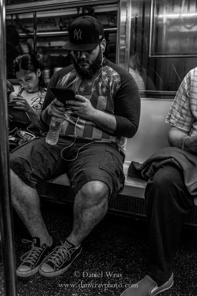 Electronics on the Subway, Manhattan, New York.