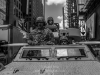 Military vehicles passing through Time Square, Manhattan, New York.