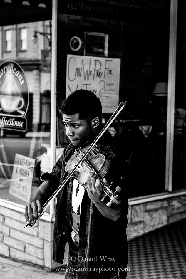 Young violin player on the street outside of Glory Beans Coffee House in Albemarle, North Carolina.