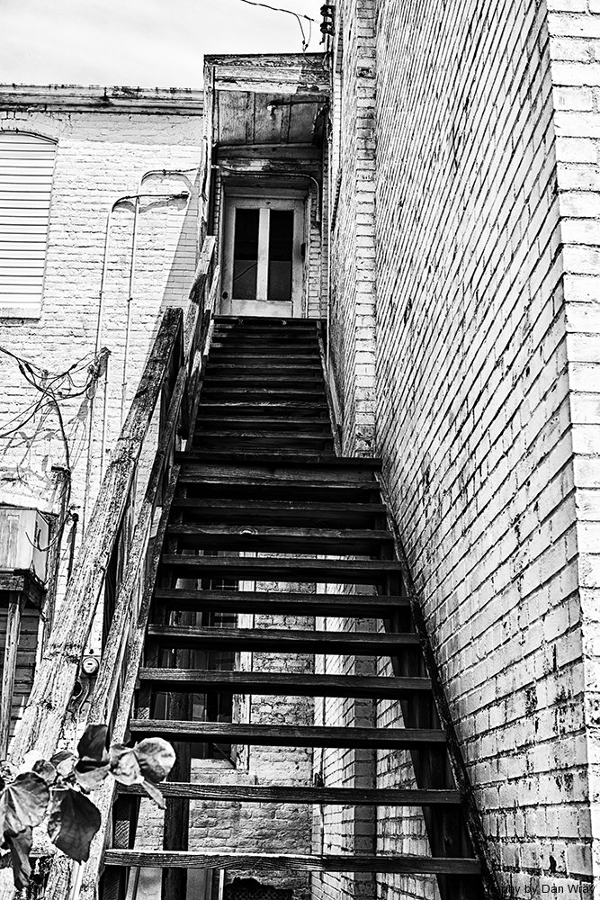 The back stairway in an old building, Albemarle, North Carolina.