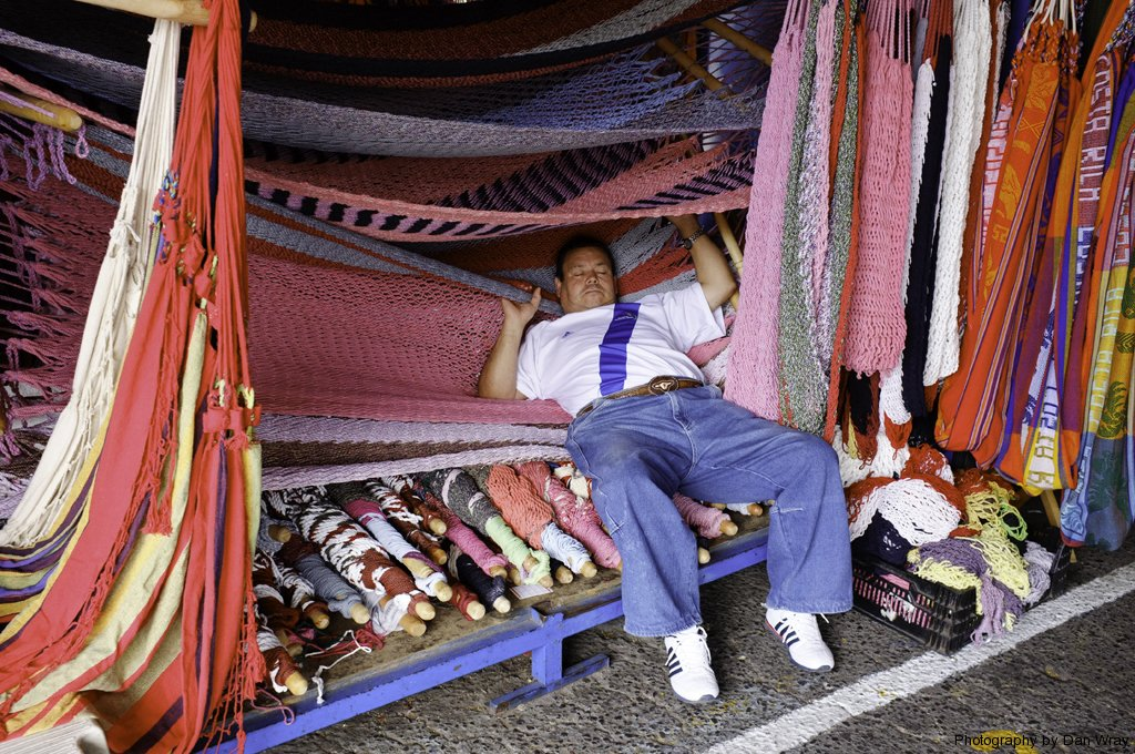 A sleepy salesman in the Natioal Arts and Crafts Market in San Jose, Costa Rica.