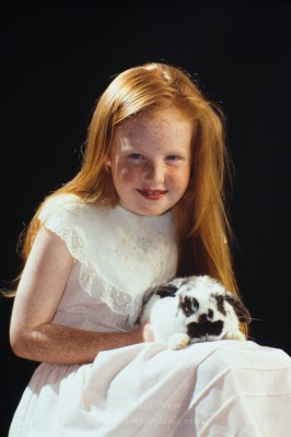 Portrait of red headed girl and rabbit.