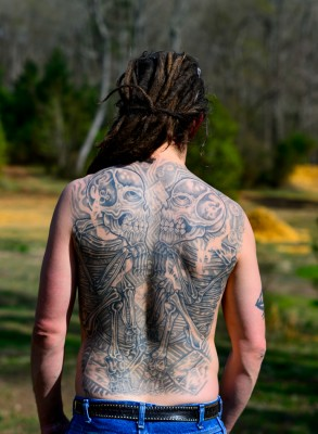Full back tatoo on man, skeleton, skull, bones. (MR)