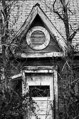 Entrance door to abandoned house.