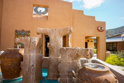 Large stone water fountain at the historic Santuario de Chimayo, New Mexico.