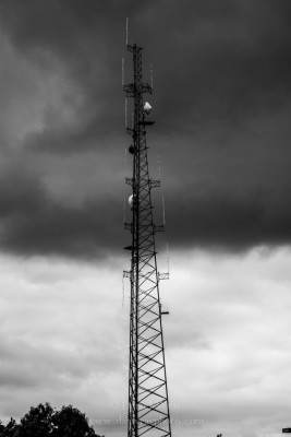 communications tower and brewing storm clouds.
