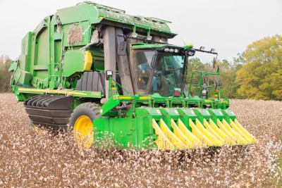 Cotton Harvester in cotton field.