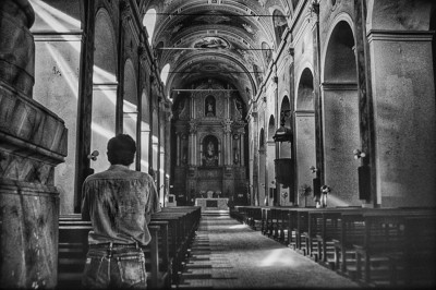 Man in prayer at a church in Santa Fe, Argentina.