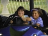 Sisters (9 & 7 years old) riding in bumber cars at Stanly County Fair, North Carolina. (MR)