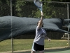 Fifteen year old girl taking tennis lessons. (MR)