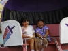Sisters in tilt-a-whirl ride, Stanly County Fair, North Carolina. (MR)