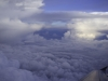 In the clouds on an airline flight.